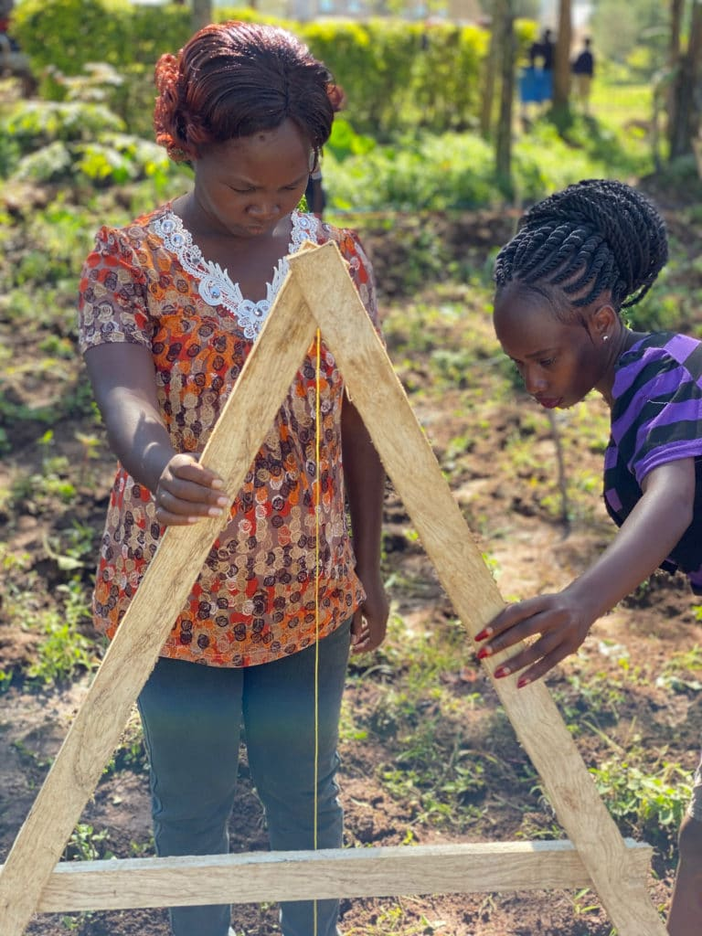 Penina and Ruth surveying the land with A-Frame.