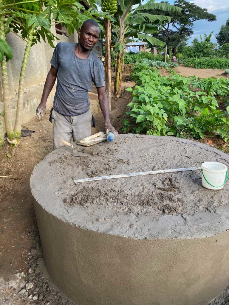 Reuben the stone mason with the finished rainwater tank base