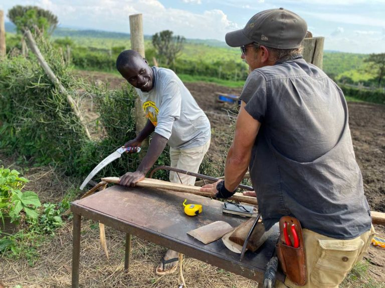 Linford and Brandon working on gutter installation for the rainwater catchment