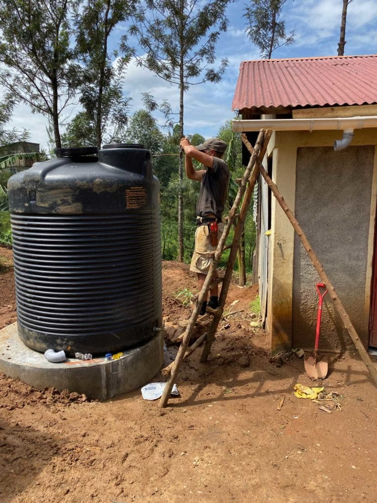 Brandon working on the new rainwater tank and catchment system